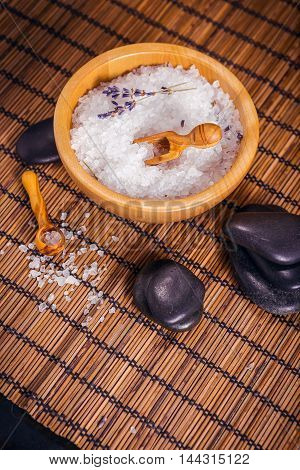 Spa and wellness setting with Zen stones natural soap sea salt and towel.