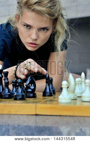 Woman Makes A Move Chess Elephant.