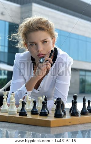 Girl Holds A Chess King In Her Hand