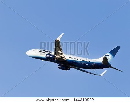 Moscow - July 31 2016: passenger plane Boeing 737-83N / W Alrosa-Avia airline flies to Domodedovo airport and on a background of blue sky July 31 2016 Moscow Russia