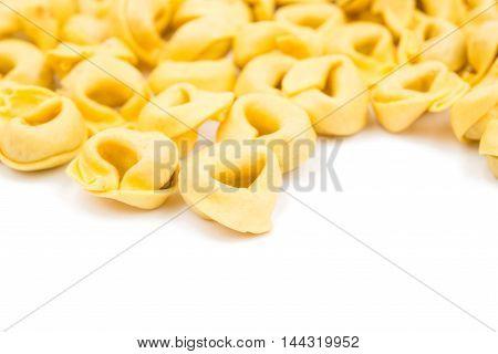 tortellini  pasta, raw on a white background