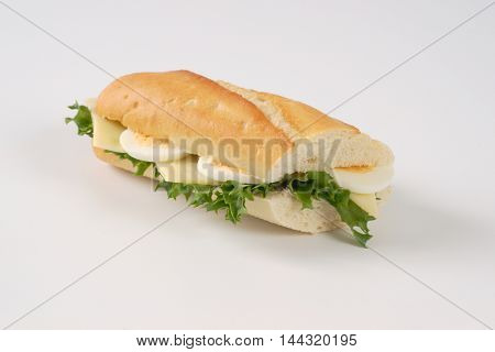 sandwich with eggs and cheese on white background