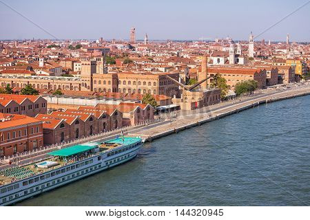 A panoramic view of Venice with a big cruise ship docked in the foreground Venice Italy