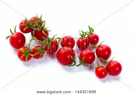Small cherry tomatoes on white background isolated
