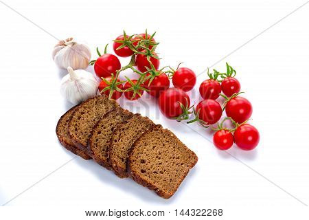 Set of black bread slices cherry tomatoes and garlic