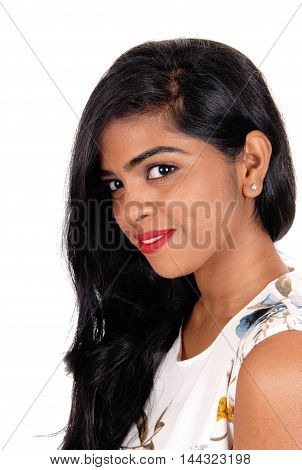 A portrait image of a lovely young Indian woman with long black hair looking into the camera isolated for white background.