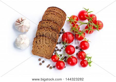 Set of bread slices bunch of cherry tomatoes and garlic