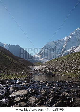 View Of The Valley. Stream. Mountains