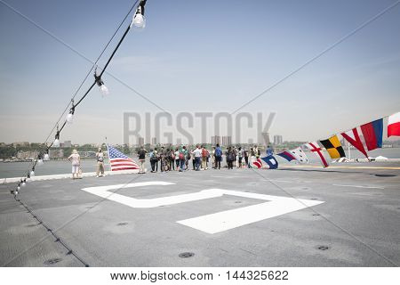 NEW YORK MAY 26 2016: Public tours allow civilians to walk around the flight deck of the USS Bataan (LDH 5) an amphibious assault ship moored at Pier 88 for Fleet Week NY 2016.