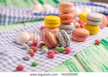 Dessert still life with sweet macaroon cookies and marshmallow
