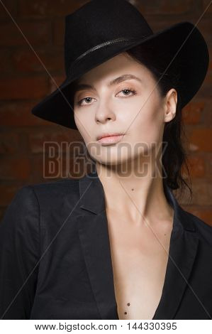 Elegant Fashionable Woman Wearing Black Suit And Hat In A Vintage Interior