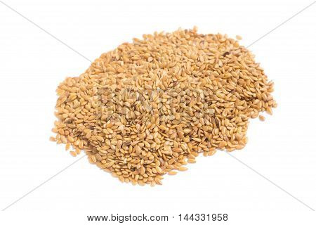 Close-up on a gold linseed in white background
