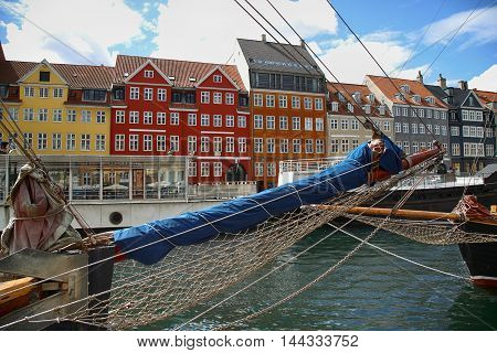 Yacht and color houses in seafront Nyhavn (new Harbor) in Copenhagen Denmark