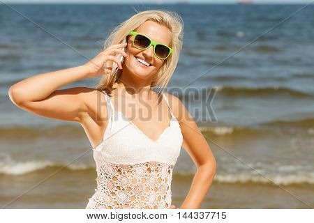 Woman Talking On Mobile Cell Phone By Seaside
