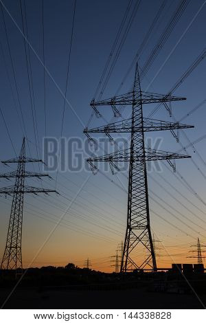 High voltage power line against blue sky at dawn