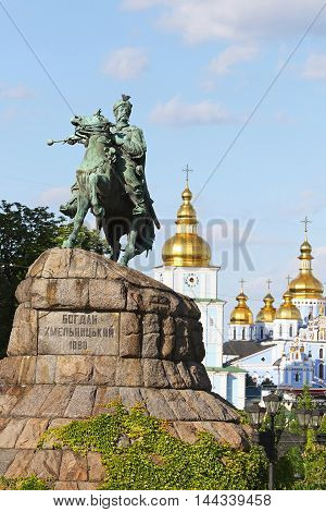 Monument of Bohdan Khmelnytsky the Hetman of Ukrainian Zaporozhian Cossacks on Sofia square in Kyiv Ukraine. St. Michael's Golden-Domed Monastery on the background