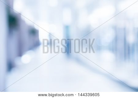 medical blurred background empty hospital corridor in neon blue light