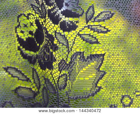 Curtain with a floral motif and green background