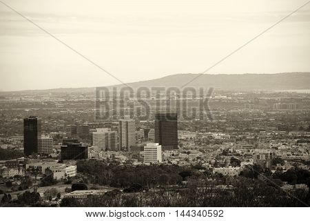 The skyline of Los Angeles with various skyscrapers in the city center surrounded by parks and infrastructure.