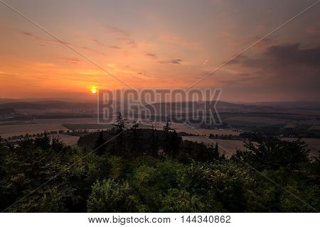 Magical view of the sunset from a lookout tower Maly Chlum. Moravian landscape.