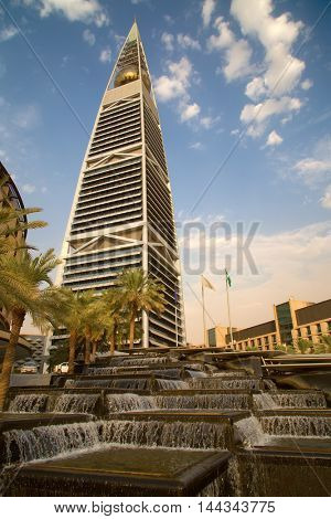 RIYADH - AUGUST 22: Sunset light at Al Faisaliah tower facade on August 22, 2016 in Riyadh, Saudi Arabia. Al Faisaliah towers is a luxury hotel and the most distinctive skyscraper in Saudi Arabia