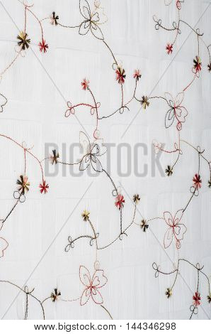 Texture. White Fabric With Embroidered Flowers.