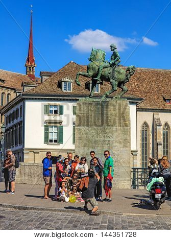 Zurich Switzerland - 21 August 2015: tourists at the monument to Hans Waldmann in the historic part of the city. Zurich is the largest city in Switzerland it is also the capital of the Swiss canton of Zurich.