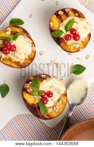 Top view of delicious Grilled peaches dessert.