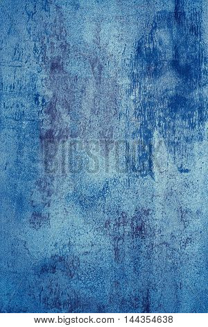 Closeup of metal surface painted in blue color.