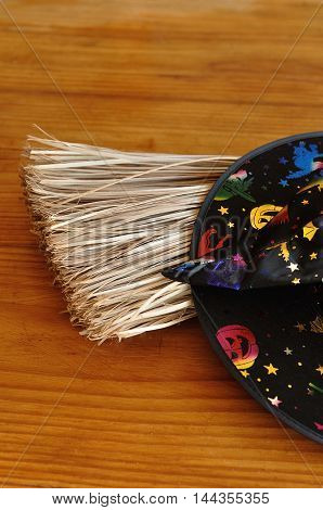 A colorful witches hat displayed with a broom
