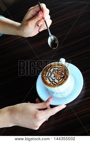 Cup of cappuccino. Beautiful female hands, cafe, drink, milk, latte,