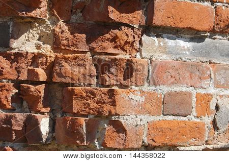 Texture background. Brick wall. Fragment of Venetian old brick wall as background. Red brick wall texture background. Old brick wall texture background