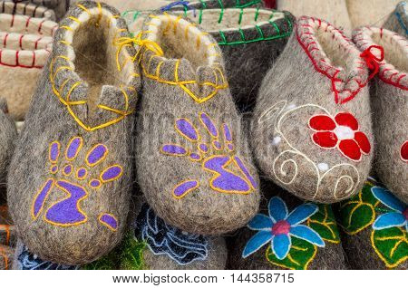 Felt slippers. A pile of gray felt slippers in the traditional Russian exhibition. Slippers