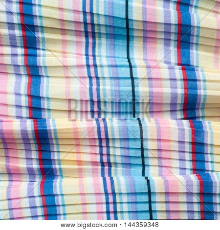 Pleated fabric. Sinii yellow red white stripes texture. Photography Studio