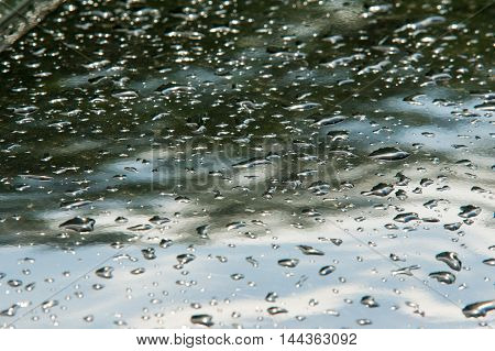 Texture, Background. Raindrops. On The Paintwork Of The Vehicle. Painted Surfaces In A Building Or V