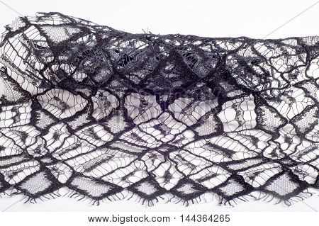 The texture of lace on the fabric. Slim beautiful lace