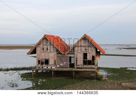 Thale Noi lake at Phatthalung,Twin house is abandons on wetland at southern of Thailand.