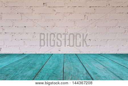 Blue wooden table top with brick wall decorated in coffee shop