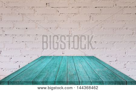 Perspective blue wooden table top with brick wall decorated in coffee shop