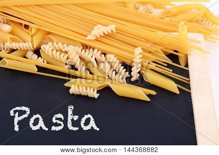 various types pasta with blackboard. Food concept.