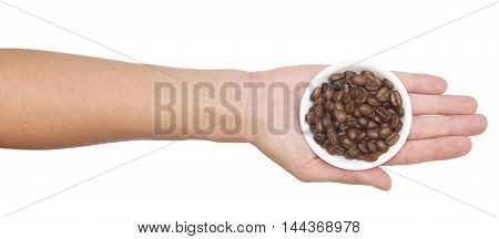 coffee beans in a bowl on a hand isolated on white