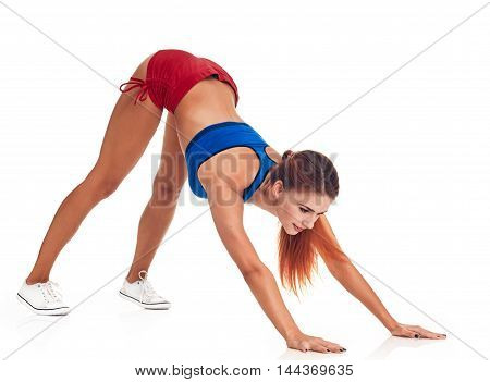 Fit woman exercise on floor, white background
