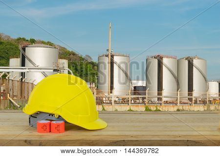 Oil Refinery Industry And Yellow Safety Helmet With Blue Sky Background