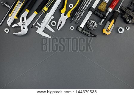 House Renovation Tools And Accessories On Dark Grey Background