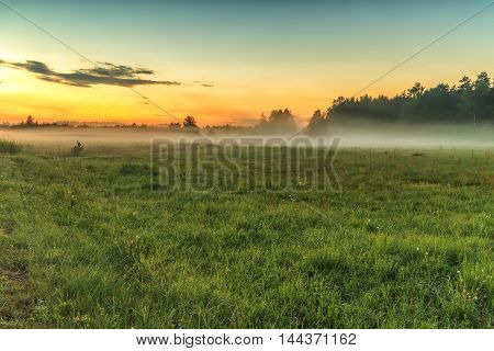 Fog Covers The Fields In Evening