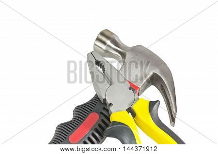 Hammer and pliers isolated over white background