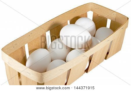 Chicken eggs in basket on white background