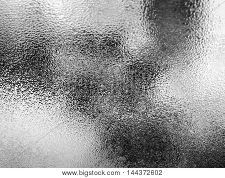 Window glass with condensation in black and white