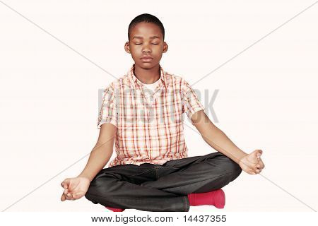 Ethnic boy yoga meditation
