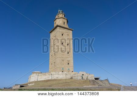 LA CORUNA, SPAIN - AUGUST 20, 2016: The Tower of Hercules with blue sky. The tower is the oldest Roman lighthouse in use today and overlooks the Atlantic coast of Spain from A Coruna.
